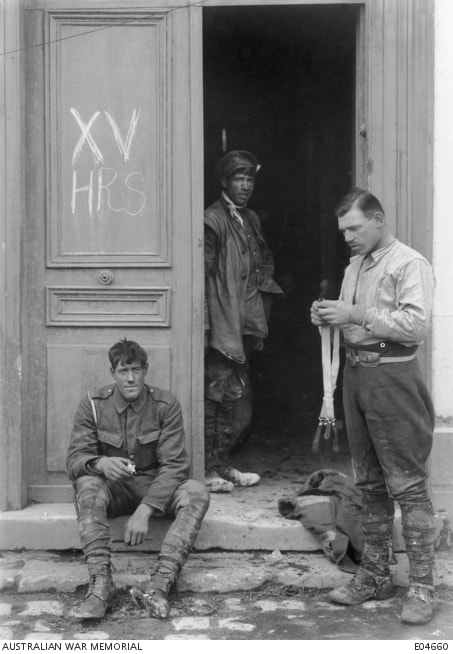 Corbie, France. 31 March 1918. Informal portrait of British cavalrymen cleaning up at Corbie after several days' hard fighting. Note the initials XV HRS on the door on the left.